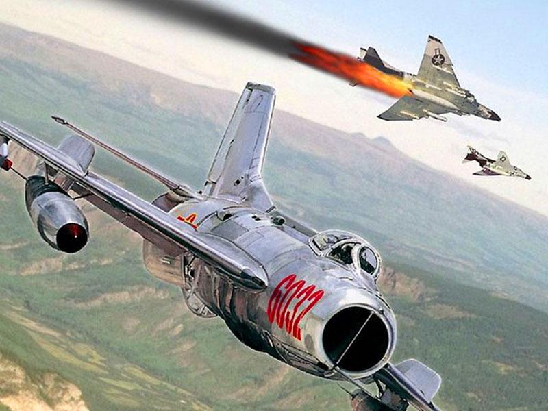 Вьетнамский МиГ-19С ведет бой с американскими «Фантомами» (рисунок)
