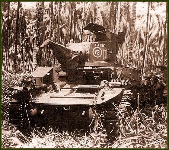Легкий танк М3 «Стюарт» из состава 2-го батальона 6-го танкового полка австралийской армии. Папуа Новая Гвинея, декабрь 1942 года. Машина имеет собственное имя «Cabby» и тактический номер 12. Круг желтого цвета, что обозначает принадлежность танка ко 2-му батальону