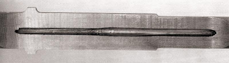 Продольный разрез ствола в зоне дополнительной зарядной каморы. Отчетливо видно увеличение диаметра канала от воздействия пороховых газов